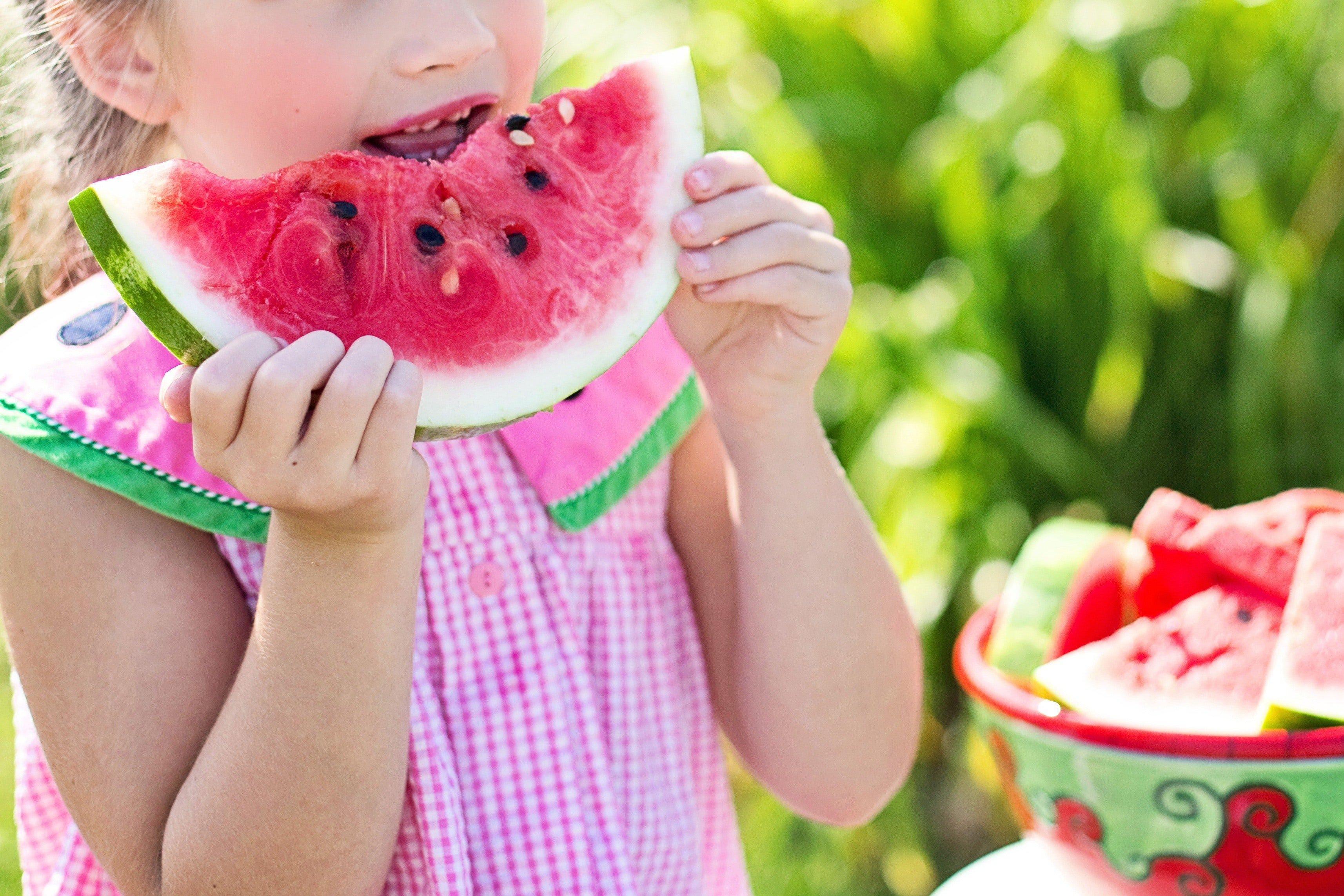 messy eating girl eating watermelon