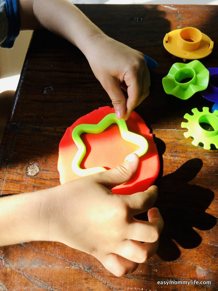 toddler playing with play-doh-indoor activities for 3 year olds